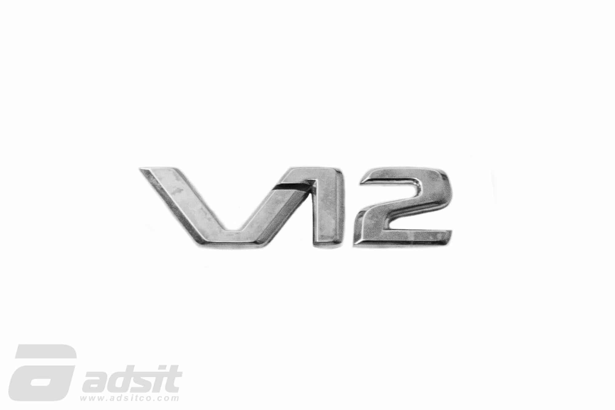 V12 BADGE